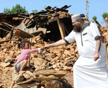 Imam Qasim with a child
